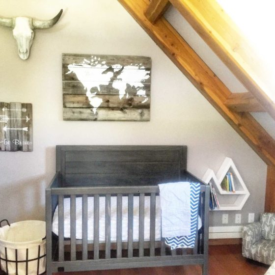 vintage style baby room with crib and wall art