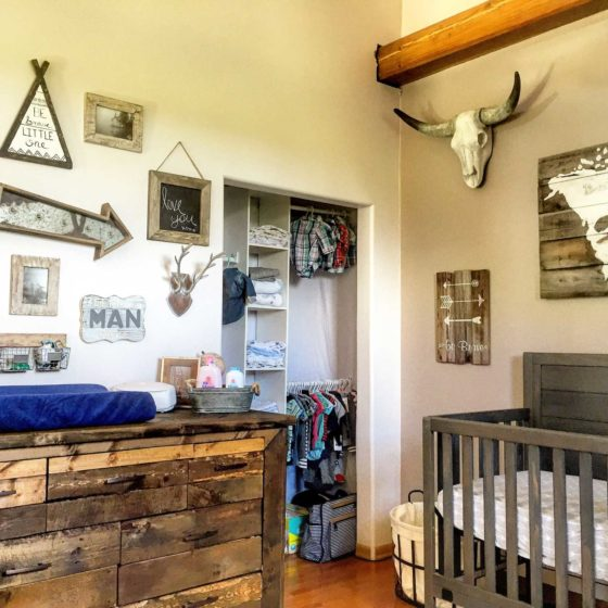 Vintage style baby room with wall art