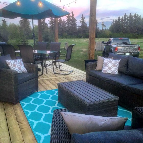 Treated lumber deck with patio furniture